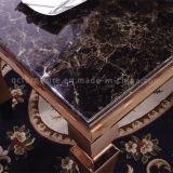Tabella pranzante moderna dell'oro con la parte superiore di marmo