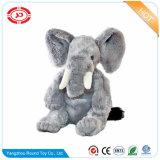 De yeux étranges reposant le jouet mou d'éléphant animal fait sur commande de peluche