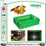 Légumes de supermarché et caisses compressibles de fruits