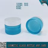 Bereifte blaue kosmetische Glaslotion-Flaschen und Gläser mit silberner Schutzkappe