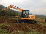 Máquina escavadora hidráulica da roda da máquina escavadora e máquina escavadora da esteira rolante junto