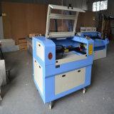 Machine van de Graveur van de Laser van Co2 CNC van het Knipsel en van de Gravure van de Laser van het Leer van de Raad van China 60W 80W 6090 de Houten Acryl voor Verkoop