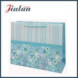 쇼핑 선물 종이 봉지가 광택이 없는 박판으로 만들어진 아이보리페이퍼 반짝임에 의하여 꽃이 핀다