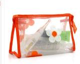 Le sac cosmétique de PVC de bouton clair fait sur commande composent le sac