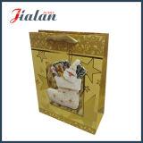 La venta caliente modifica la bolsa de papel para requisitos particulares impresa insignia del regalo de Chrsitmas
