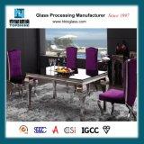 居間の家具のための新し設計されていた緩和された塗られたガラステーブルの上