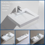 A parede branca pura pendurou o dissipador de pedra da vaidade do banheiro da bacia