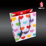 Papel colorido del bolso del regalo del amor para los amantes