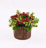 Flores artificiales de Navidad con la baya en el crisol del cemento para la decoración del día de fiesta