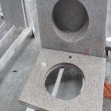Bancadas do granito e partes superiores de pedra da vaidade com bacia e furos de conexão