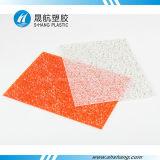 オレンジカラーによって浮彫りにされるポリカーボネートのダイヤモンドの広がること