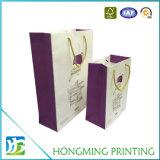 호화스러운 로고는 밧줄 손잡이를 가진 선물 종이 봉지를 인쇄했다
