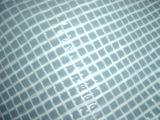 Сплетенная конструкцией сетка толя ткани