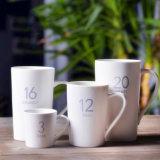 Tazze di caffè di ceramica delle tazze del regalo con il disegno di marchio del cliente