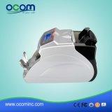 Dinero Ocbc-2118 que cuenta el contador de la impresora