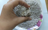 Streifen-Bentonit-Katze-Sand - saubere aufhäufende einfache Schaufel