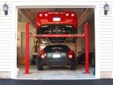 Elevador hidráulico do estacionamento de quatro bornes do cilindro elétrico da liberação uma auto/elevador estacionamento do carro