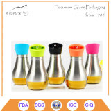 Petrolio di vetro, aceto, bottiglia della salsa con il coperchio d'acciaio di Stainess ed erogatore
