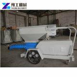 La mano fa funzionare la macchina concreta diesel della pompa di iniezione di cemento liquido della vite