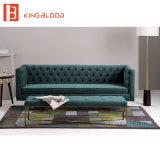 Il tessuto del sofà chiama il sofà verde scuro del tessuto del coperchio