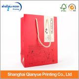 ハンドルが付いている中国の赤い紙袋