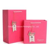 분홍색 색깔에 있는 숙녀의 선물 포장 종이 봉지