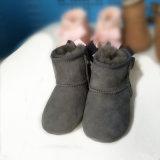 Теплый ботинок младенца овчины зимы с смычком Bailey