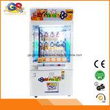 Máquina de jogo premiada a fichas do guindaste do Vending da redenção dos miúdos
