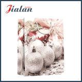 Les ventes en gros personnalisent le sac de empaquetage de papier de Noël estampé par cadeau de sucrerie de vacances
