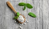 Tablettes normales de Stevia d'édulcorant dans le distributeur
