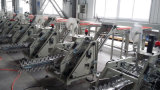 自動2台のベルトの紐で縛る重量を量り、包装機械