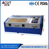 Máquina de gravura do laser do CNC na estaca material e na gravura