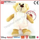 Urso macio novo da peluche do brinquedo no pano