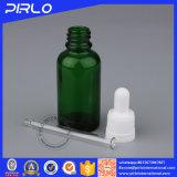 Botella de cristal vacía del color verde del uso del petróleo esencial con el casquillo del cuentagotas