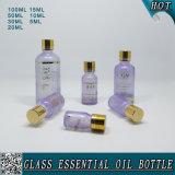 Bouteille en verre cosmétique vide d'huile essentielle colorée par coutume