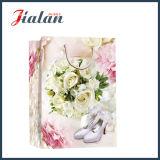 Sac de papier en ivoire stratifié lustré de cadeau d'achats de chaussure de mariage de papier