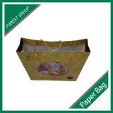 リボンのハンドルが付いている顧客用ペーパーショッピング・バッグ