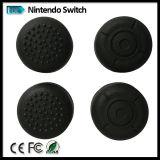 Le pelli antiscorrimento del coperchio del silicone dell'interruttore della Nintendo, cassa protettiva per il regolatore di Gioia-Imbroglione con il pollice afferra le protezioni