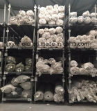 Textiel Industrieel Pakhuis die het Rek van de Broodjes van de Stof van de Opslag stapelen