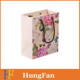 Papier Kraft imprimé personnalisé promotionnel Shopping Emballage Porte-cadeau Sac à papier cadeau avec poignées
