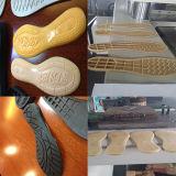靴の足底のための縦の射出成形機械