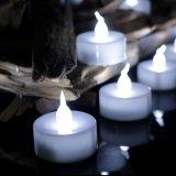 La luz sin llama del té del LED mira al trasluz la vela con pilas de Unscented