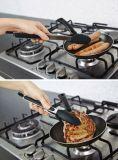 Tendre les pinces anti-caloriques d'ustensiles de cuisine de produits chauds