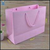 Bolso de compras blanco del papel de Kraft de la impresión rosada para la ropa