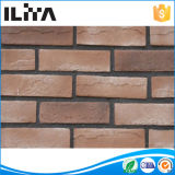 A parede de superfície contínua de pedra artificial por atacado folheia tijolos de face