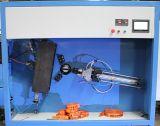 Correas del arnés que cortan y máquina de bobina
