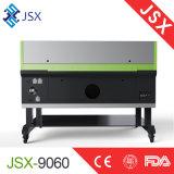 Comitati acrilici del cuoio del tessuto di Jsx9060 80W che intagliano la macchina del laser dell'incisione di taglio