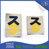 L'indumento contrassegna il contrassegno tessuto vestiti su ordinazione dell'emblema