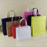 流行のロゴの習慣によって印刷される贅沢なギフトのショッピング紙袋