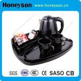 Пластичный электрический чайник с радушными комплектами подноса